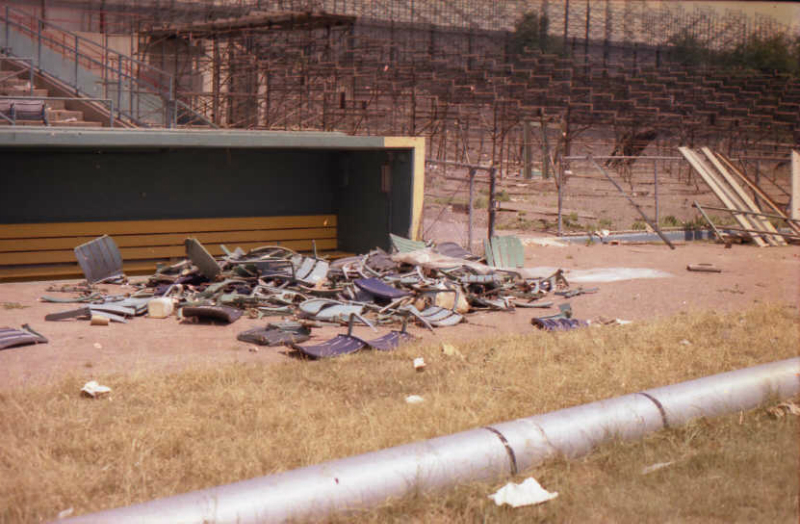 abandoned26-pile-of-broken-seat-backs-in-front-of-the-third-base-visitors-dugout