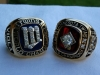 1987 and 1991 World Series rings side-by-side