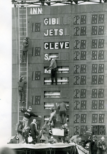 Fans tear off pieces of the Metropolitan Stadium scoreboard after the last game ever played at the facility – a Minnesota Vikings loss to the Kansas City Chiefs on December 20, 1981.