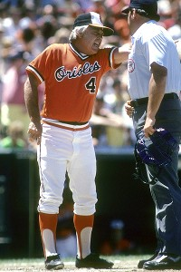 Earl Weaver discussing the play with the umpire.