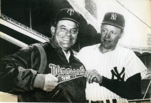 Yankee manager Ralph Houk inspects the jacket of Twins manager Cookie Lavagetto prior to the Twins first ever game, played April 11, 1961 at Yankee Stadium. Twins win 6-0.
