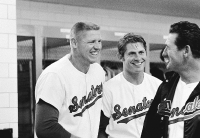 Manager Ted Williams, right, of the Washington Senators and two home run hitting outfielders flash big grins in the dressing room after defeating the New York Yankees 9-6, April 10, 1969, Washington, D.C. Frank Howard, left, slammed two home runs, bringing his total to four in the first three games of the season, while Brant Alyea hammered another four-bagger. (AP Photo/Charles W. Harrity)